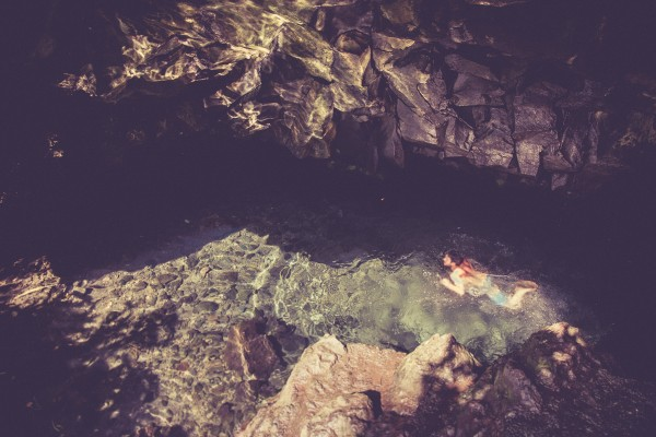 Noah getting a swim in the freshwater caves.